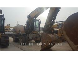 Caterpillar M313D, wheel excavator, Construction