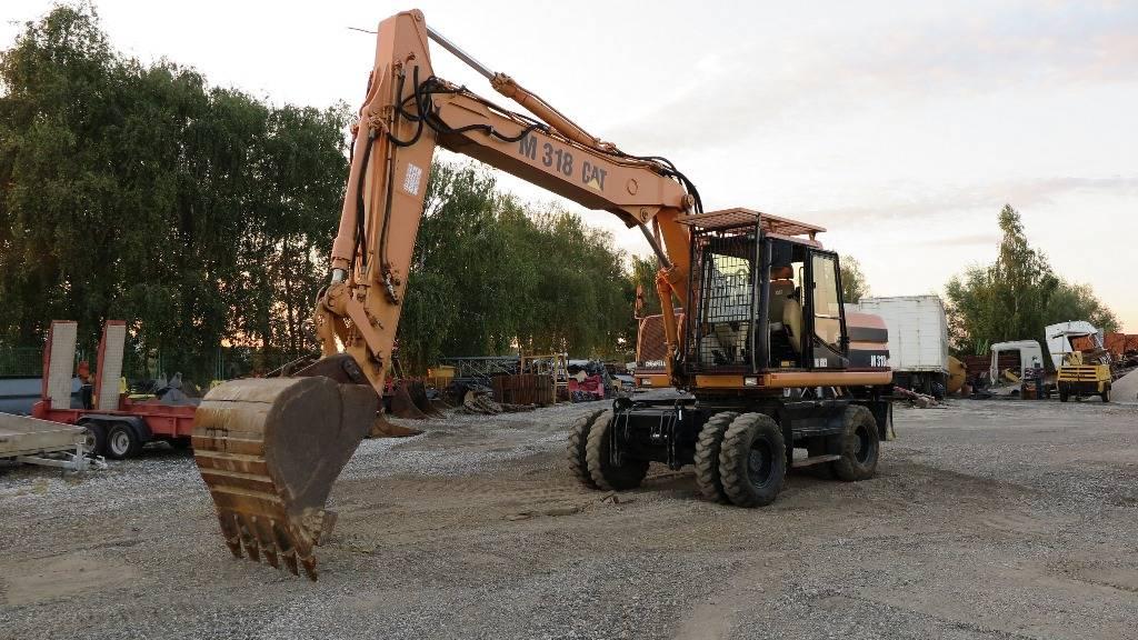 Caterpillar M318, Bageri na kotačima, Građevinarstvo