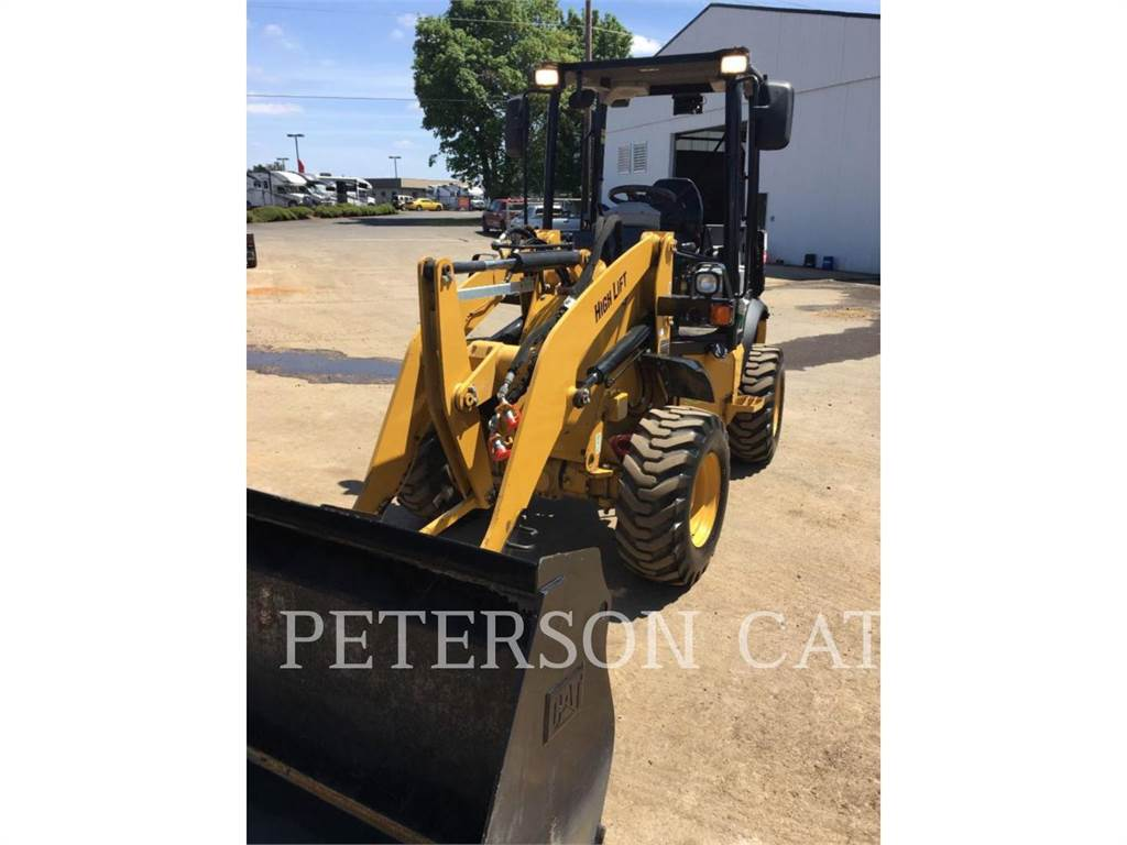 Caterpillar 903C2, Incarcator pe pneuri, Constructii