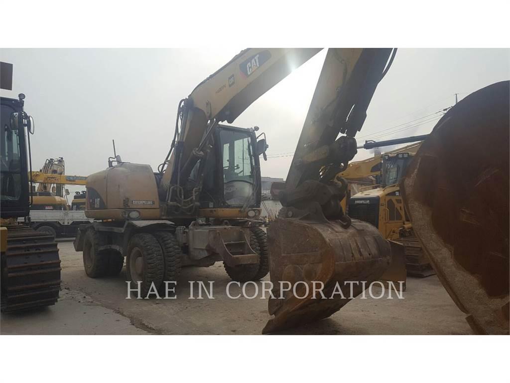 Caterpillar M313D, pelles sur pneus, Équipement De Construction