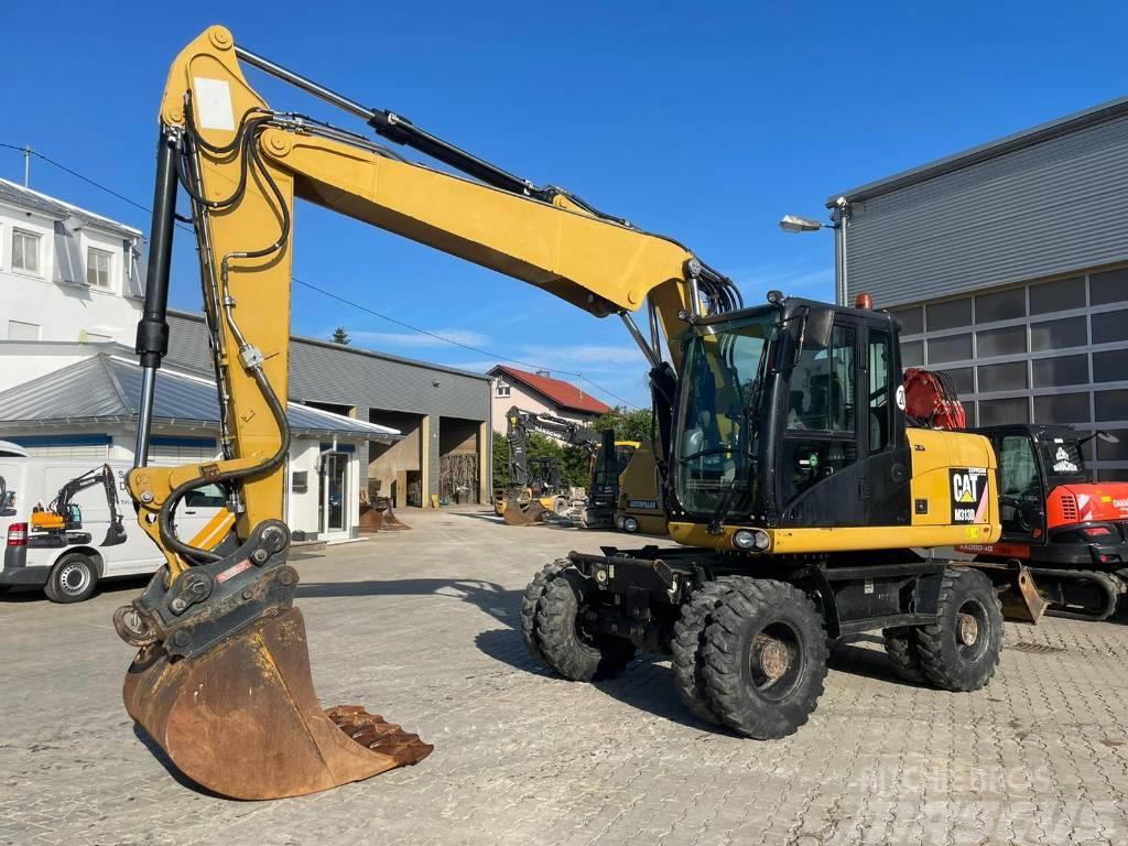 Caterpillar M 313 D mit Oil Quick 70/55