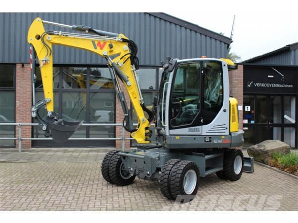 neuson ew65 wheeled excavators year of manufacture. Black Bedroom Furniture Sets. Home Design Ideas