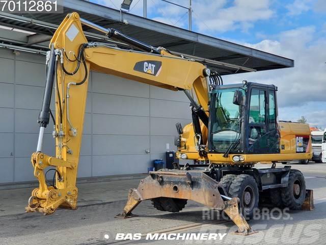 Caterpillar M318D German dealer machine - outriggers and blade