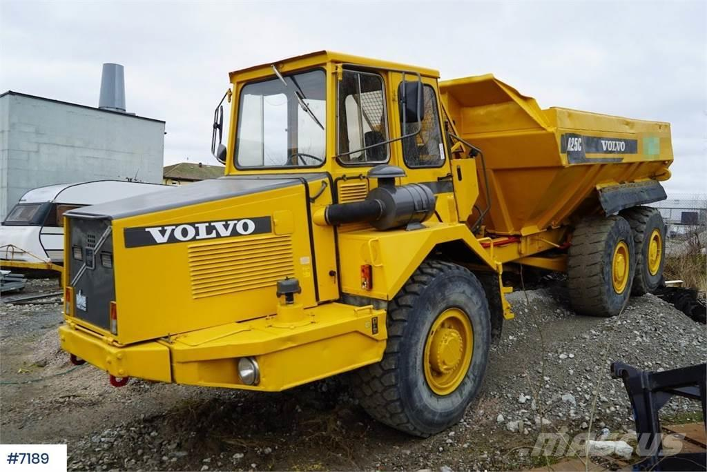 Volvo A25C with white signs