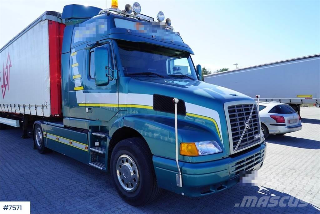 Volvo NH12 420 w/ 2 trailers
