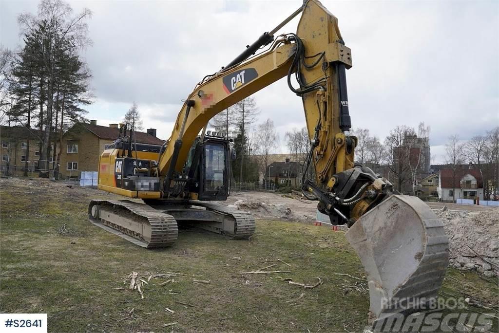 Caterpillar 324EL Excavator with various tools