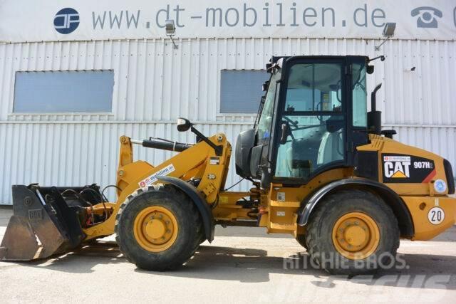 Caterpillar 907 H2 Klappschaufel & Palettengabel Breitreif