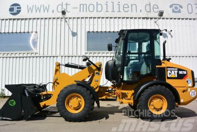 Caterpillar 907M Klappschaufel & Palettengabel