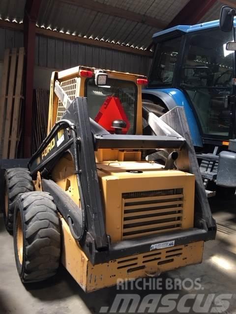 New Holland 553 skridstyret minilæsser
